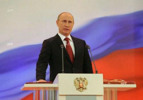 Putin_godi6no_obra6enie_otzad_bqlo_sinio_4erveno